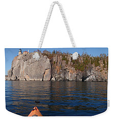 Weekender Tote Bag featuring the photograph Kayaking Beneath The Light by James Peterson