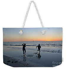 Weekender Tote Bag featuring the photograph Kids At The Beach by Robert Meanor