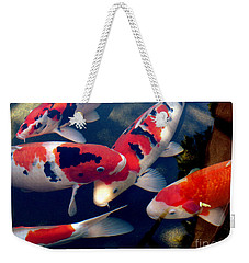 Weekender Tote Bag featuring the photograph koi by Irma BACKELANT GALLERIES