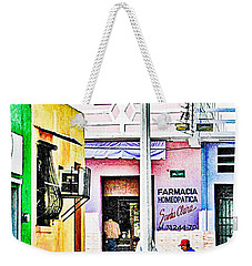 Weekender Tote Bag featuring the photograph La Farmacia by Jim Thompson