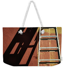Ladder And Shadow On The Wall Weekender Tote Bag by Gary Slawsky