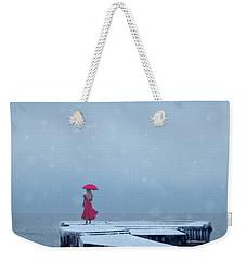 Lady In Red On Snowy Pier Weekender Tote Bag by Jill Battaglia