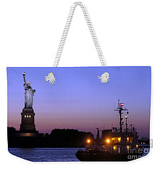 Weekender Tote Bag featuring the photograph Lady Liberty At Dusk by Lilliana Mendez