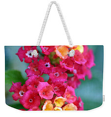 Weekender Tote Bag featuring the photograph Lantana by Henrik Lehnerer