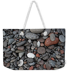Weekender Tote Bag featuring the photograph Lava Beach Rocks by Jani Freimann
