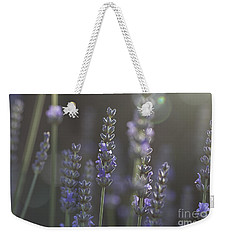 Weekender Tote Bag featuring the photograph Lavender Flare. by Clare Bambers