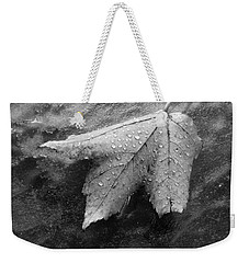 Leaf On Glass Weekender Tote Bag by John Schneider