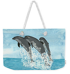 Weekender Tote Bag featuring the painting Leaping Dolphins by Tracey Williams