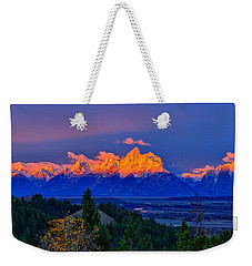 Weekender Tote Bag featuring the photograph Let There Be Light by Greg Norrell