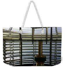 Weekender Tote Bag featuring the photograph Light House Lamp by Susan Garren