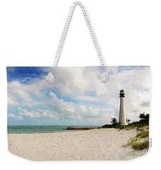 Light House On The Beach Weekender Tote Bag by Carsten Reisinger