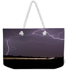 Weekender Tote Bag featuring the photograph Lightening Bolts by Charles Beeler