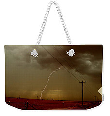 Lightning Strike In Oil Country Weekender Tote Bag by Ed Sweeney