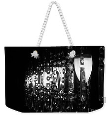 Weekender Tote Bag featuring the photograph Lightwork by Clare Bevan