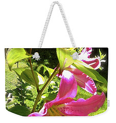 Weekender Tote Bag featuring the photograph Lilies In The Garden by Sher Nasser