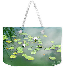 Weekender Tote Bag featuring the photograph Lilly Pads by Erika Weber
