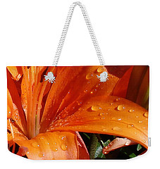 Weekender Tote Bag featuring the photograph Lily Drops by Kerri Mortenson