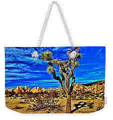 Weekender Tote Bag featuring the photograph Lone Joshua by Benjamin Yeager