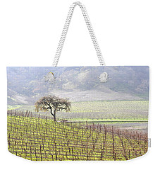 Weekender Tote Bag featuring the photograph Lone Tree In The Vineyard by AJ  Schibig