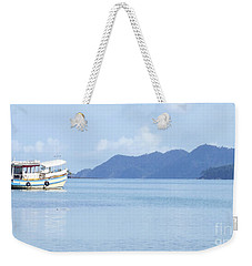 Weekender Tote Bag featuring the photograph Lonely Boat by Andrea Anderegg