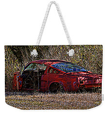 Weekender Tote Bag featuring the photograph Lonely Fastback by Victor Montgomery