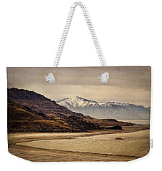 Weekender Tote Bag featuring the photograph Lonesome Land by Priscilla Burgers