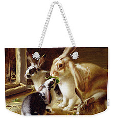 Long-eared Rabbits In A Cage Watched By A Cat Weekender Tote Bag