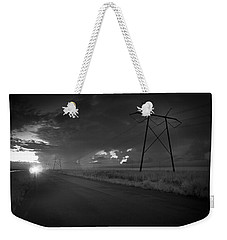 Weekender Tote Bag featuring the photograph Long Road Home by Bradley R Youngberg