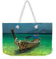 Weekender Tote Bag featuring the photograph Longboat by Adrian Evans