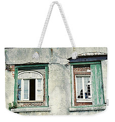 Weekender Tote Bag featuring the photograph New Orleans Looking Thru And Beyond by Michael Hoard