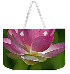 Weekender Tote Bag featuring the photograph Lotus Bloom by Jerry Gammon
