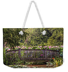 Weekender Tote Bag featuring the photograph Lotus Garden Pond And Bridge by Jerry Gammon
