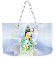 Weekender Tote Bag featuring the photograph Lotus-holding Kuan Yin by Lanjee Chee