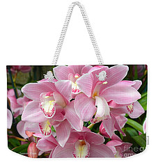 Weekender Tote Bag featuring the photograph Cymbidium Pink Orchids by Jeannie Rhode