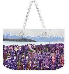 Weekender Tote Bag featuring the photograph Lupins At Tekapo by Nareeta Martin
