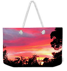 Weekender Tote Bag featuring the photograph Magenta Sunset by DigiArt Diaries by Vicky B Fuller