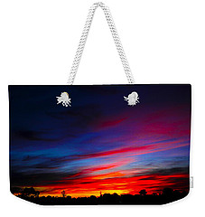 Weekender Tote Bag featuring the photograph Magnetic Dawn by Mark Blauhoefer