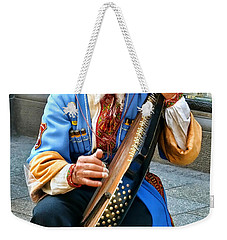 Weekender Tote Bag featuring the photograph Making A Living by Mariola Bitner