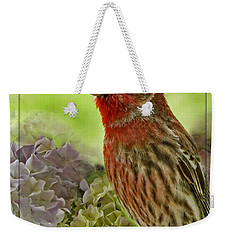 Weekender Tote Bag featuring the photograph Male Finch In Hydrangesa by Debbie Portwood