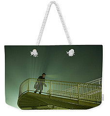 Weekender Tote Bag featuring the photograph Man On Stairs With Case In Fog by Lee Avison