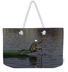 Man Plying A Wooden Boat On The Dal Lake Weekender Tote Bag