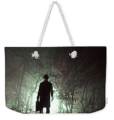 Weekender Tote Bag featuring the photograph Man Waiting In Fog With Case by Lee Avison