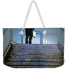 Weekender Tote Bag featuring the photograph Man With Case At Night On Stairs by Lee Avison