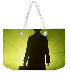 Weekender Tote Bag featuring the photograph Man With Case In Green Light by Lee Avison