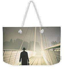 Weekender Tote Bag featuring the photograph Man With Case On Bridge by Lee Avison