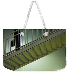 Weekender Tote Bag featuring the photograph Man With Case On Steps Nighttime by Lee Avison