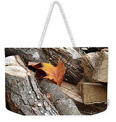 Weekender Tote Bag featuring the photograph Maple Leaf In Wood Pile by Brenda Brown