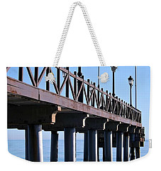 Weekender Tote Bag featuring the photograph Marbella Pier Spain by Clare Bevan