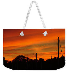 Weekender Tote Bag featuring the photograph Marina Sunset by Deena Stoddard