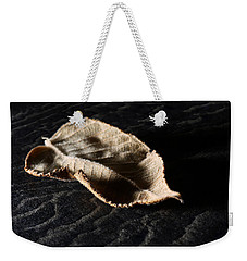 Weekender Tote Bag featuring the photograph Meanwhile The World Goes On by Lauren Radke
